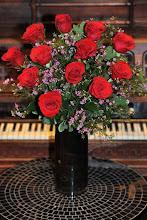 Photo: Dozen Red Roses in Dark Vase