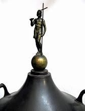 Photo: A keresztelőmedence bronztetején Keresztelő Szent János szobra áll.