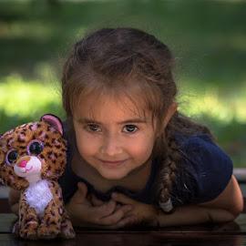 riendliness by Gabi Radoi - Babies & Children Child Portraits ( child, friendliness, green, innocence, blur,  )