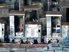 Photo: 003 A close-up of two versions of the Ruston LA. The one on the left is an early example with a short coreless motor that leaves the cab completely clear, whilst the later one on the right has a longer one, but with the advantage of increased torque over the short motor .