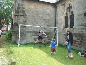 Photo: Reuben tests the goalie's skill
