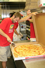 """Photo: This is my Hot, Huge & Delicious 28"""" PiZza.  We cut it into 12 huge slices  Each slice is a huge 14"""" slice that  needs two plates to hold it on!   ASk for the $39.99 special we have on it right now!"""