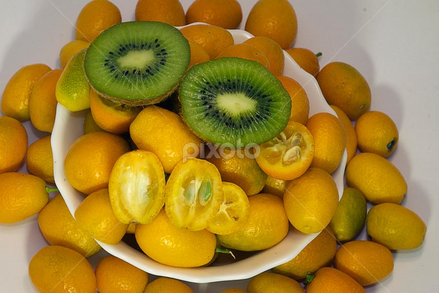 colorful citrus fruits close up by LADOCKi Elvira - Food & Drink Fruits & Vegetables ( orange, citrus, green, kiwi, fruits )