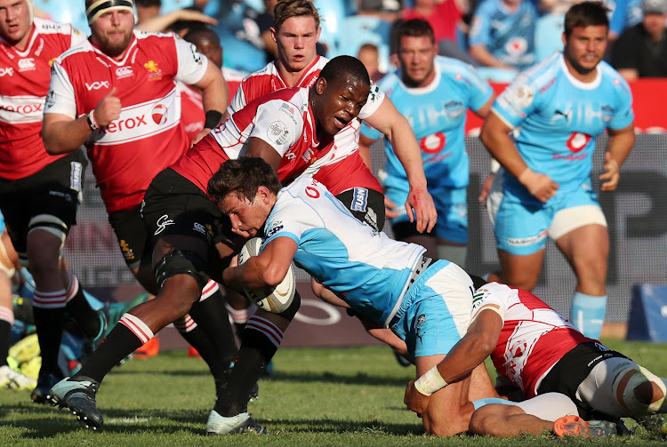 JT Jackson of the Bulls is tackled by Hacjivah Dayimani of the Lions during the Currie Cup match between Blue Bulls and Golden Lions at the Loftus Versveld Stadium, Pretoria on September 1 2018.