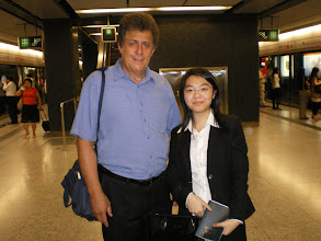 Photo: Girl in the subway who guided us to Hong Kong Harbor.  Tom gave her a Book of Mormon in Chinese