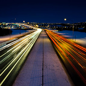 A street at night by Páll Jökull Pétursson - City,  Street & Park  Street Scenes ( lights, iceland, traffic, red, winter, reykjavik, street, white, night, pwc83: night light )