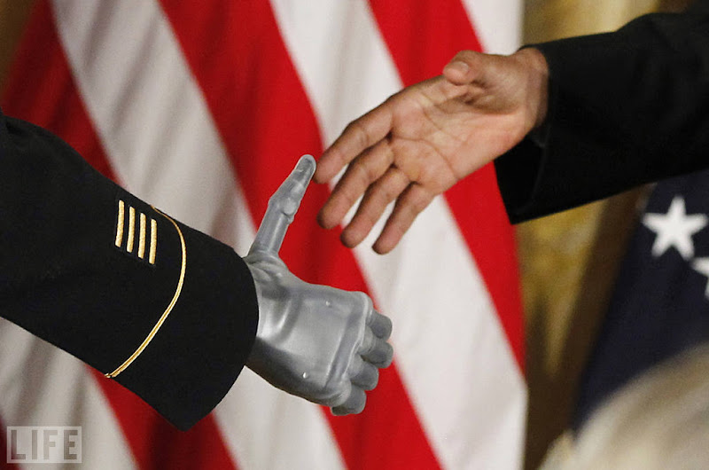 Photo: President Barack Obama shakes the prosthetic hand of U.S. Army Sgt. Leroy Arthur Petry of Santa Fe, N.M., who received the Medal of Honor on July 12. Petry lost his right hand during a 2008 firefight in Afghanistan as he tossed aside a live grenade, saving the lives of his fellow Army Rangers. Photo: Charles Dharapak/AP Photo Jul 13, 2011