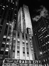 Photo: A shot of Radio City Music Hall with 30 Rock in the background. I took this shot a couple of years ago and it is still one of my favorite shots from New York. I wish I'd had just a slightly wider angle lens to capture just a bit more of Radio City, but it is what it is.