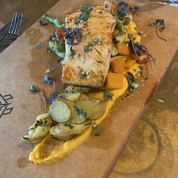 SALMON Pan-seared salmon, butternut squash purée, olive oil poached fingerling potatoes, salsa verde, succotash – grilled corn, Brussels sprouts, asparagus, butternut squash and grape tomato