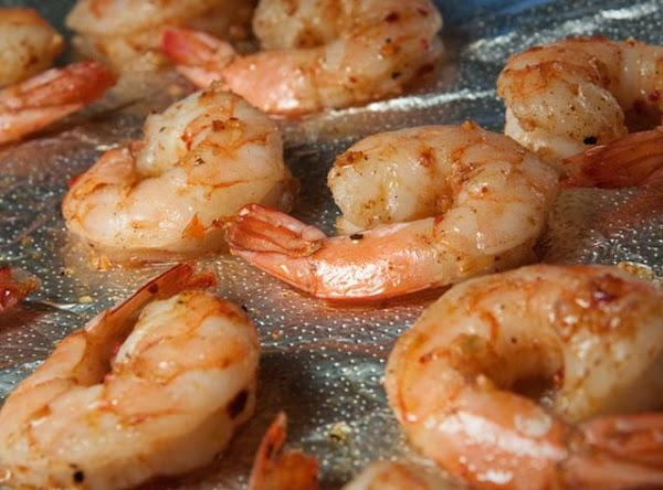 Peel and devain shrimp leaving tails on. Drizzel with olive oil, adoba (or s&p)...