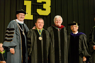Photo: Al Hunt (third from left), political journalist, joins President Casey, Board chair Martin K.P. Hill, and Interim Provost and Professor Tom Zirpoli. Hunt received honorary Doctor of Journalism degree.