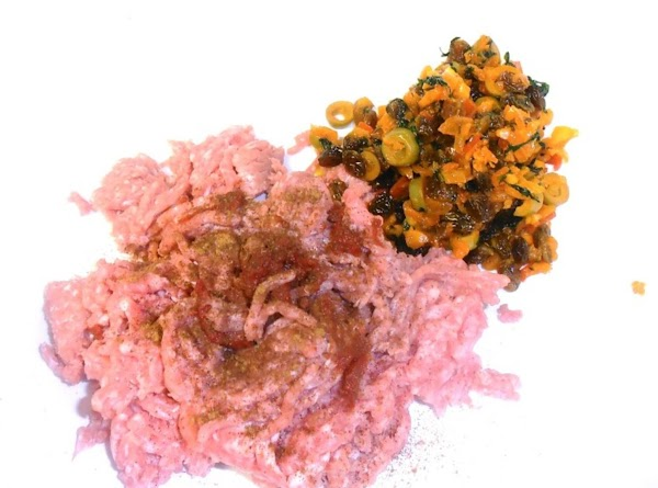 in large mixing bowl combine pork, cinnamon, cumin, tomato paste, salt and veggie mixture