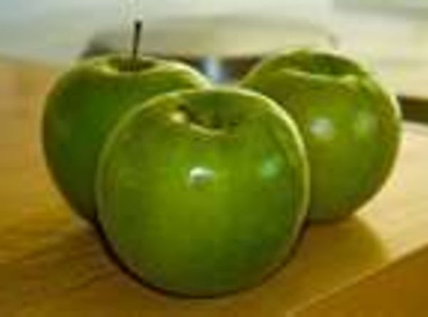 Peel, core and slice apples. Cut apple slices in half and arrange evenly over...