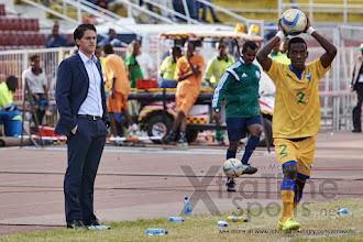 Photo: Coach McKinstry looks on as Michel Rusheshangoga (2) prepares to take a throw-in [Rwanda vs Uganda, CECAFA 2015 Final, 5 Dec 2015 in Addis Ababa, Ethiopia.  Photo © Darren McKinstry 2015, www.XtraTimeSports.net]