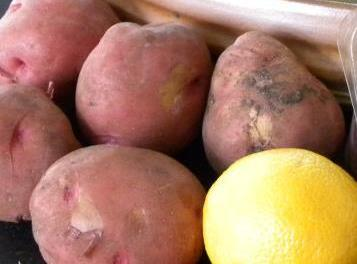 Clean and quarter potatoes, put in bowl. Zest & squeeze juice of a lemon over...