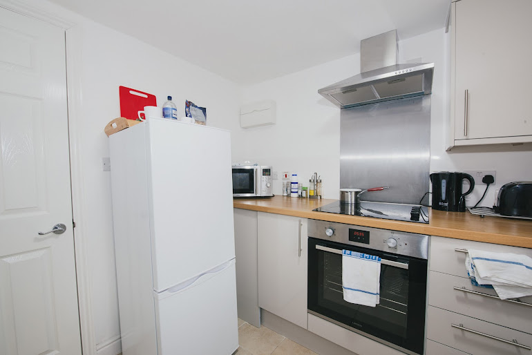 Fully equipped kitchen at River Court Apartments
