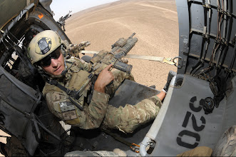 Photo: A U.S. Army special forces soldier, assigned to 1st Battalion, 101st Combat Aviation Brigade, Multi-National Base Tarin Kowt, prepares to conduct sniper platform training from inside a UH-60 Blackhawk helicopter as it makes combat maneuvers over range targets in preparation for real world combat missions, Uruzgan Province, Afghanistan, July 9, 2010.  (U.S. Air Force photo by Tech. Sgt. Michele A. Desrochers/Released).