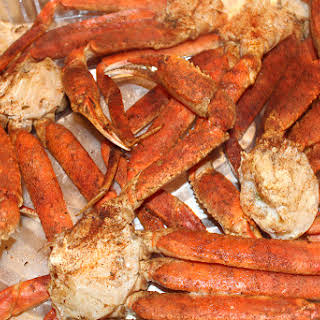 Baked Crab Legs with Creamy Garlic Butter Sauce.