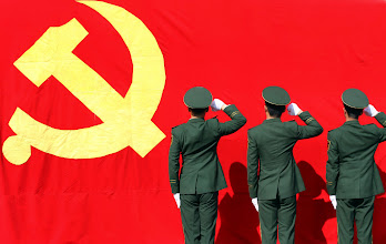 Photo: Paramilitary policement attend an oath-taking rally in Hangzhou, Zhejiang province.