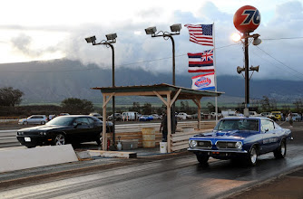 Photo: Dave Hultquist on the left in his Hemi Challenger, his wife, Irene, in the blue 'Cuda...