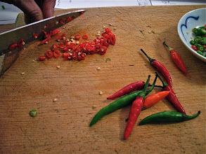 "Photo: cutting Thai chillies for crispy catfish ""lahb"""