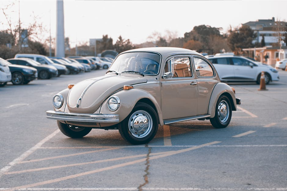 Brown Volkswagen Beetle at Parking Lot