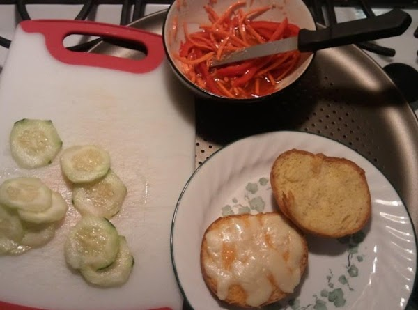 Assemble sandwich: cucumbers on cheesy slice, then top with the red pepper carrot mix....