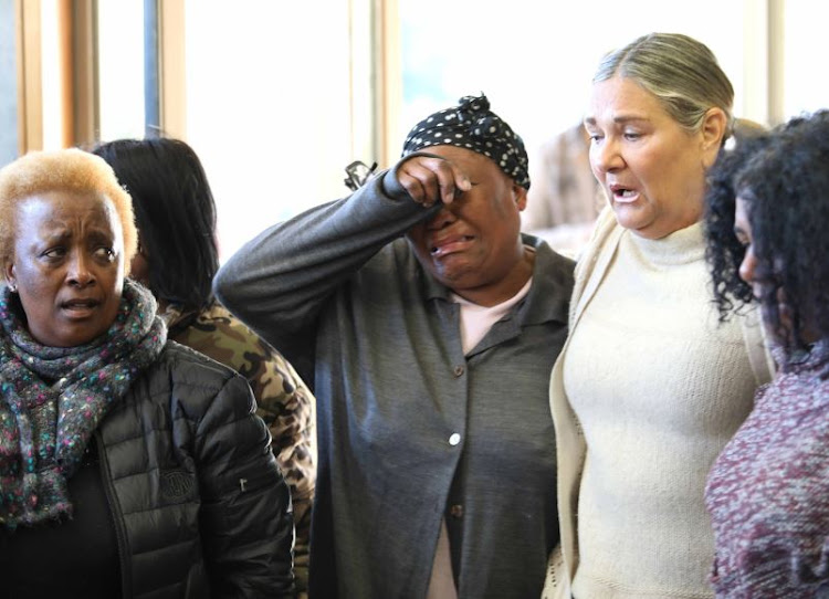 Women mourn the death of UCT student Uyinene Mrwetyana at the Clareinch post office, where she was apparently lured by her attacker.