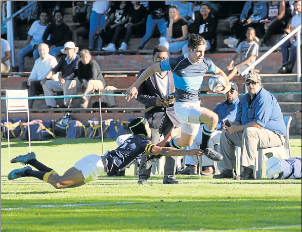 William McAdam of St Andrew's evades a despairing tackle from Graeme's Liam Agnew on his way to scoring a try in their schools rugby clash in Grahamstown on Saturday