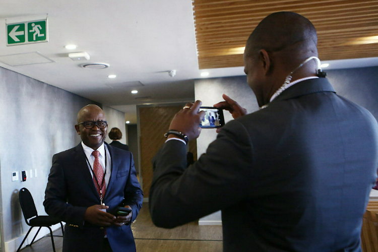 A journalist snaps a picture of former GCIS chief Themba Maseko as he arrives at the state capture commission where he has been giving his testimony. 29 August 2018