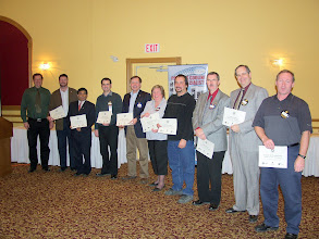 Photo: Investors from 2006-2007 who contributed between $100 and $250; From left to right:  Dave Rasmussen (RVC for RP), Glenn MacLean, Jay Doshi, Robert Lefebvre, Mike Swayne, Cathy Godin, Pierre Richer (accepting for Dilfo), Darryl Boyce, Paul Baker (accepting for Johnson Controls) and Doug Wellman (accepting for Capital Air Conditioning).