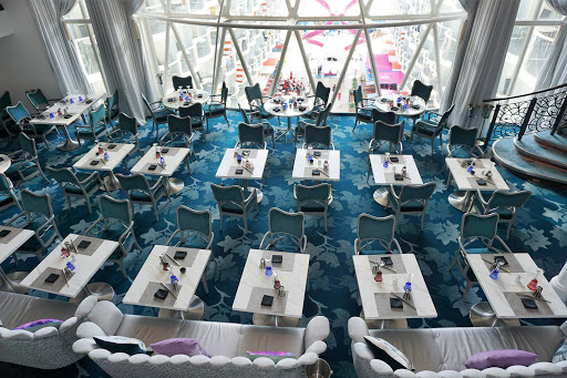 harmony-of-seas-tables.jpg - A look at the two-story Wonderland restaurant on decks 11 and 12.