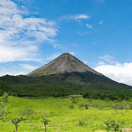 Arenal Volcano by Greg Johnson - Landscapes Mountains & Hills ( mountain, travel, vegetation, attraction, geology, danger, sky, nature, tree, action, working, central, arenal.., national, forest, tourism, rainforest, smoke, destination, country, huge, la fortuna, active, costa, big, natural, large, culture, stream, america, tropical, volcanic, landscape, cone, volcano, geography, mineral, costa rica, ecology, trip, rocks, arenal, rain, clouds, park, green, lush, plume, rica, lava, cloud, high, steam )