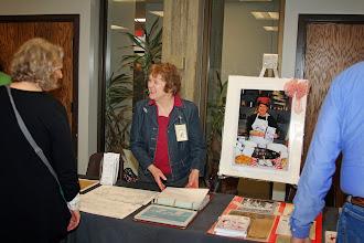 Photo: Colleen Black, featured in poster, overlooks the Oak Ridge Public Library's exhibit