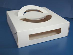 Photo: Caixa (11) Especial com alças de papel e recortes que expõe o produto dentro da embalagem - Para produtos com formatos cilíndricos.