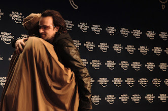 Photo: DAVOS/SWITZERLAND, 27JAN06 - Olusegun Obasanjo, President of Nigeria hugs Bono, Musician, UK and welcomes him to the session 'Next Steps for Africa' at the Annual Meeting 2006 of the World Economic Forum in Davos, Switzerland, January 27, 2006. 
