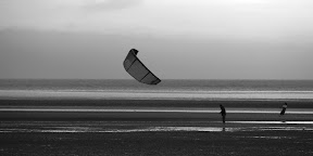 it's kite-surfing, but without the wheels. got air?