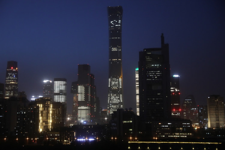 Buildings in the Central Business District (CBD) are seen lit up during the night in Beijing, China April 15 2021. Picture taken April 15, 2021. Picture: REUTERS/TINGSHU WANG