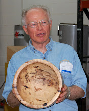 Photo: Phil Brown shows the character of his pignut hickory salad bowl.  He also explained his non-toxic finish.