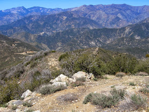 Photo: View northwest down my ridge route. The trailhead is seen on the left. I've now left the conifers behind and descend into chaparral. I see at least 12 named highpoints in this shot; I've climbed 9 of them…still need to bag Kratka Ridge, Rattlesnake Peak, and Copter Ridge. (If you can ID the 12 highpoints, you're a true peak bagger!)