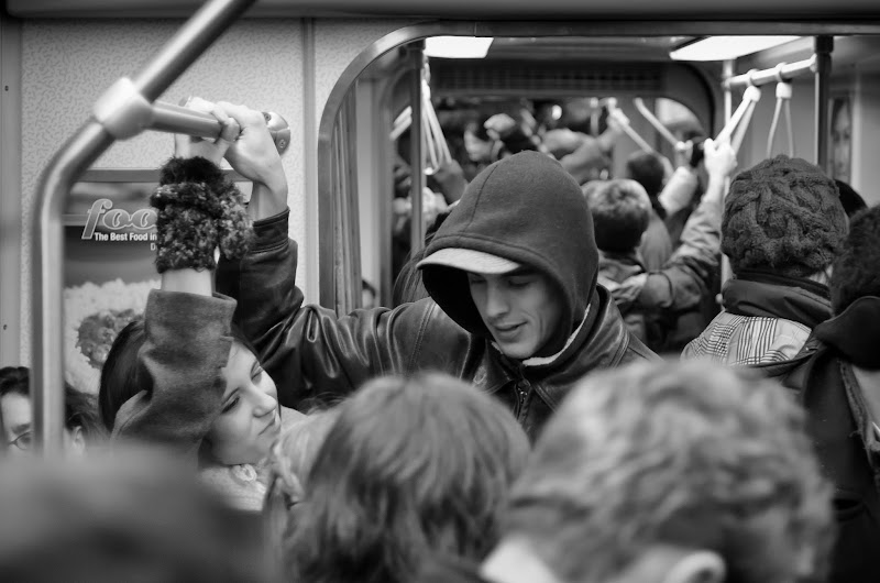 Photo: Our Time Boston, MA. 2012.  I was really afraid that we would not fit into the subway car, every inch of space was taken by someone or something, Amy and I were separated, but somehow I made it in. It was a sea of hats and cotas and gloves, and everyone was busy in their own little world, except for them.  #monochromemonday  #blackandwhitephotography