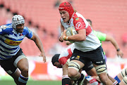 Johannes Jonker of Lions in action with Nizaam Carr of DHL Western Province during the Currie Cup match between Xerox Golden Lions and DHL Western Province at Emirates Airline Park on October 08, 2017 in Johannesburg, South Africa.