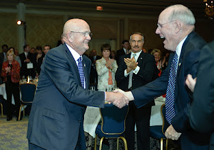 Photo: Col. (Ret.) Jim Hunt, right, congratulates, Gen. Sullivan as he heads to the stage to accept the CGSC Foundation 2009 Distinguished Leadership Award.