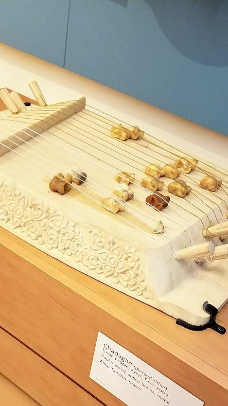 Music Instrument Museum (MIM) Geographic galleries, Chadagan (plucked zither) from Tuvan People; poplar wood, sheep bones, metal