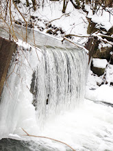 Photo: Silvery waterfall in snow at Eastwood Park in Dayton, Ohio.