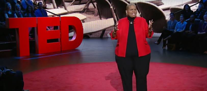 An African American woman is giving a talk at TED