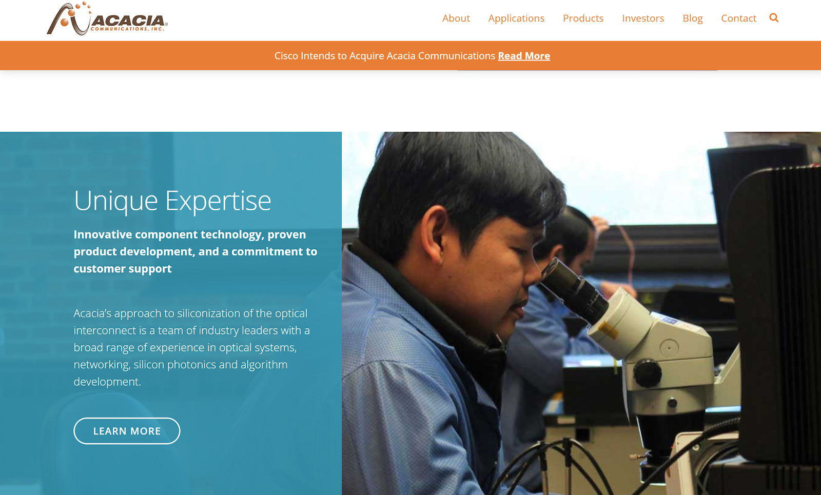 man looking into microscope on manufacturing website to express the company's unique expertise