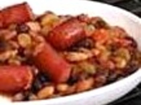 HOT DOGS WITH BAKED BEANS: In casserole dish mix 2 cans pork and beans...