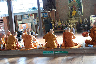 Photo: The monks eat first.  The TV is a closed circuit network.  The guy on TV is the head Abbot of Thailand.