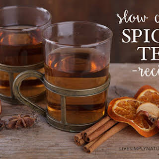 Slow Cooker Spiced Tea Recipe with Apple and Cinnamon.